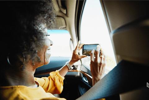 Car passenger taking a photo