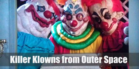 The Klowns have chalk white faces with huge smiles painted on their faces. Their costumes are an array of bright colors that clash with one another.