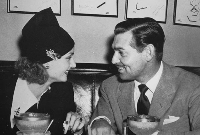 black and white photo of carole lombard and clark gable at the brown derby