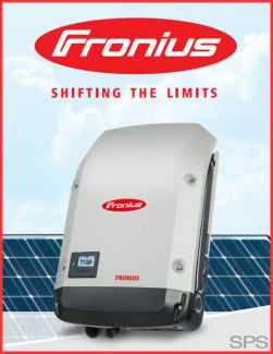 Fronius inverter with solar panels behind