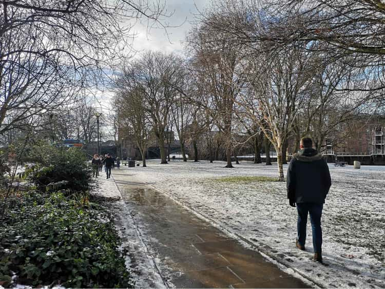 Myself walking on the snowy path through a park in the middle of York.