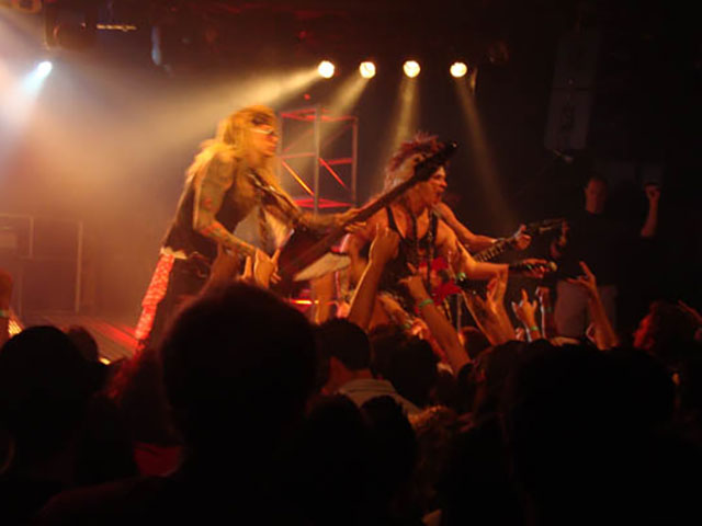 Hair Metal band melting faces in the audience with their shredding solos and big hair