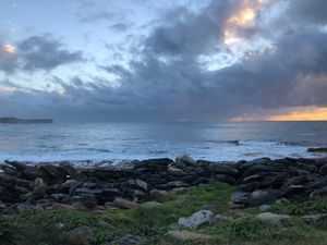 Malabar beach in Sydney with watercolour skies