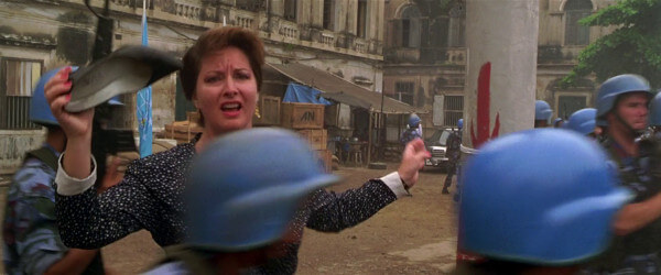 Some lady holding a shoe, whilst everyone is scrambling to start the mission