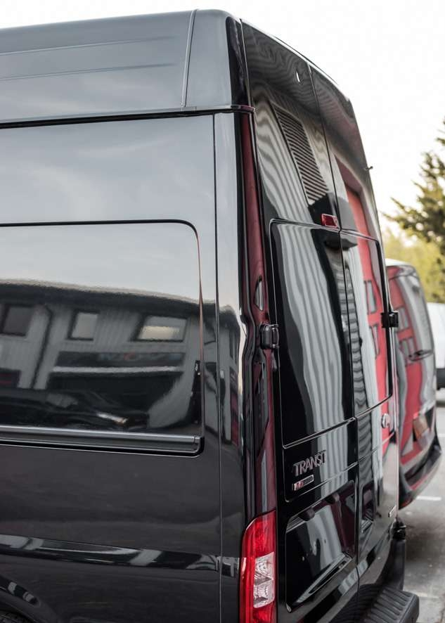 Close up shot of shiny paintwork on Ford Transit van with no scratches