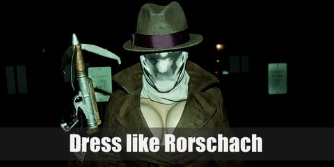 Rorschach's iconic outfit includes a brown trench coat with his matching fedora hat that has a light purple stripe, leather gloves, a grayed scarf, brown pants, elevator shoes, and an ink-blotted mask.