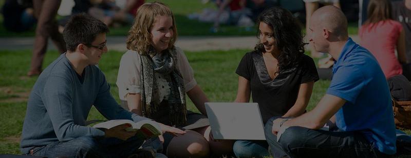 Students sitting outside at Monash University