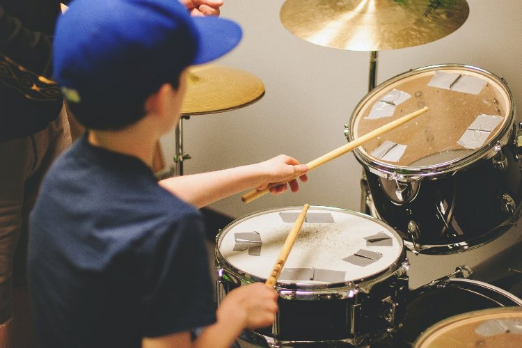 Drum lessons with student and teacher