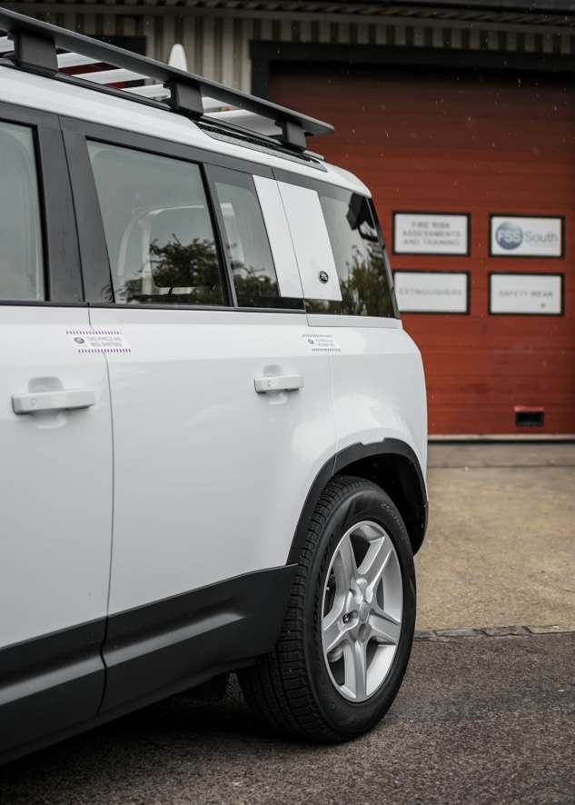 White Land Rover Defender with untinted windows before window tinting