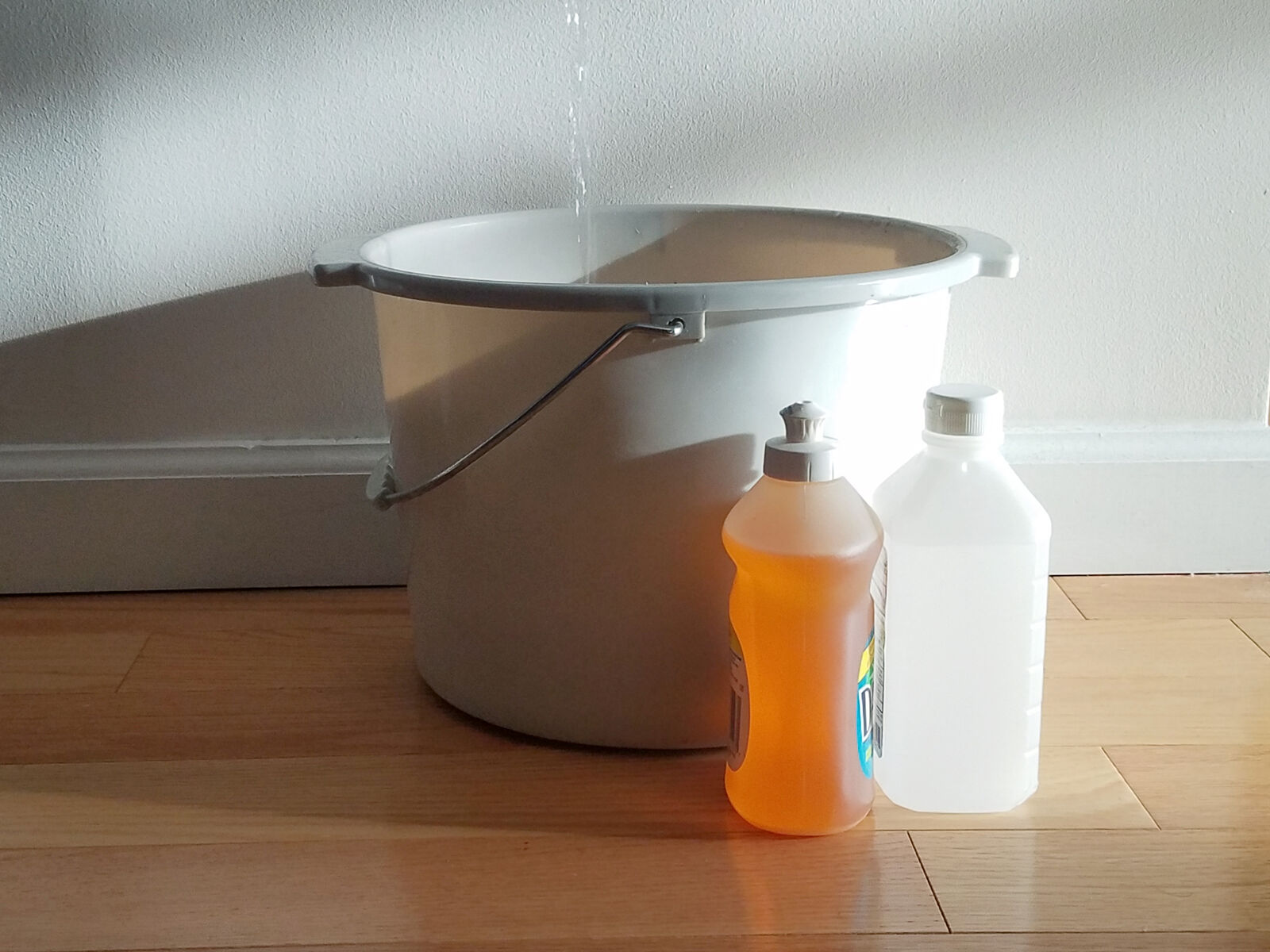 bucket of hot water with dish soap and rubbing alcohol