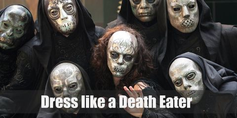 Death Eaters wear long, black hooded robes, and a fancy Death mask. They also have the Dark Mark on their forearm and their wand.
