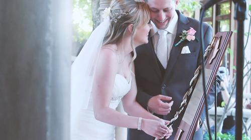 Wedding couple tying knot