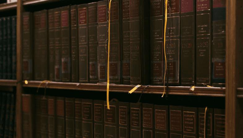 Old, ancient, historical hardback books on shelves on a wall #historicaldata