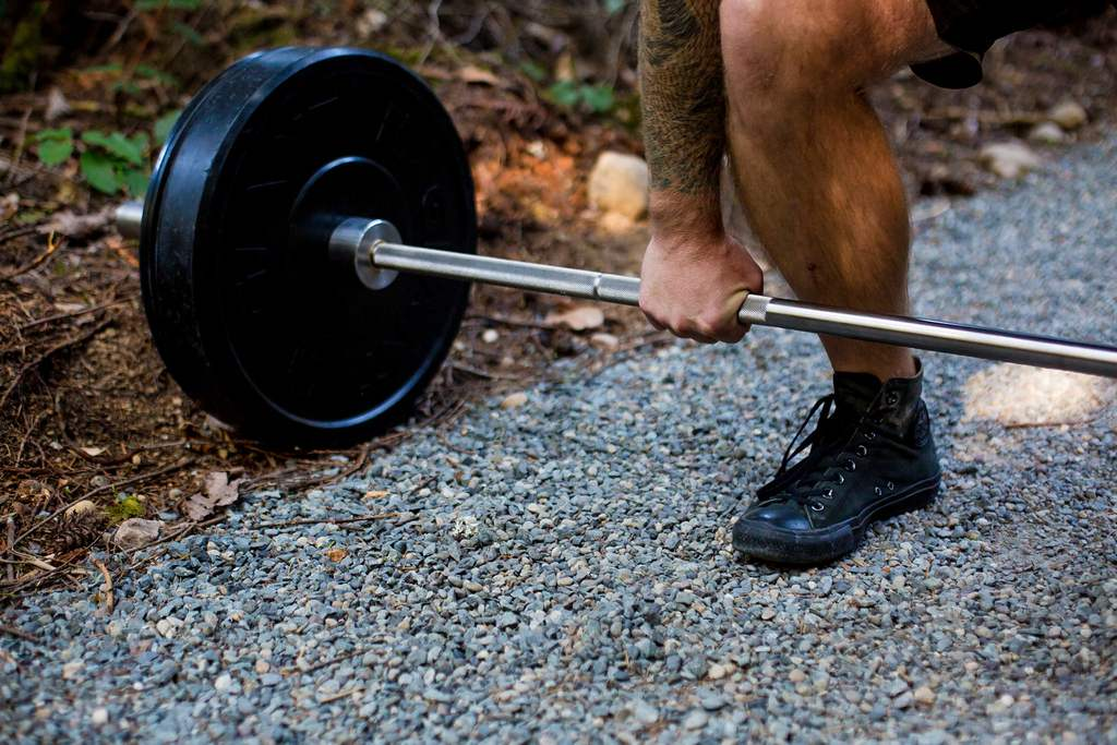 EVOLVE Strong Fitness lifting coach with barbell deadlift