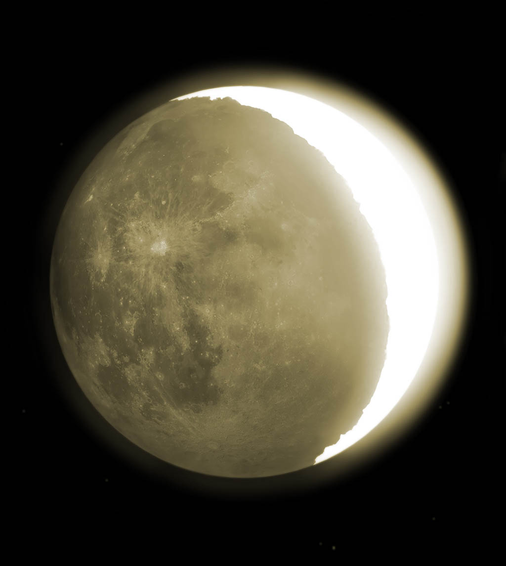 The eerie glow around a crescent moon is called earthshine.