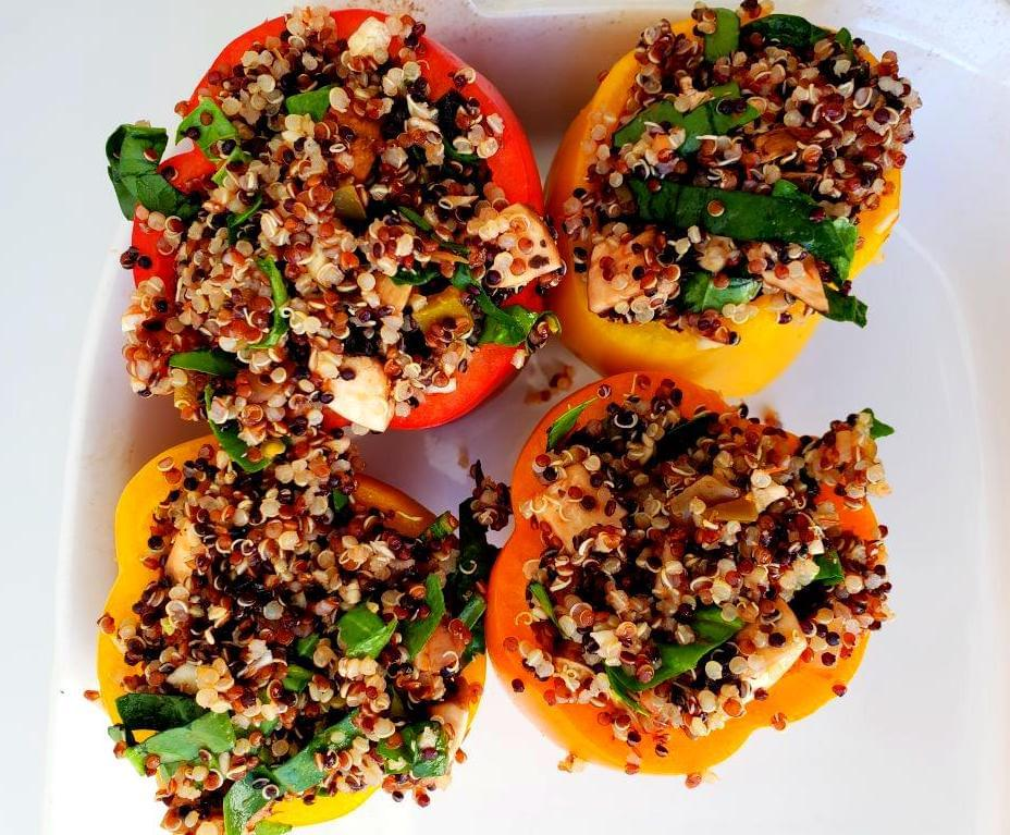 Uncooked quinoa and vegetable stuffed peppers