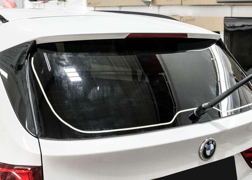 Tinted rear window on White BMW X5 using LLumar window tinting film