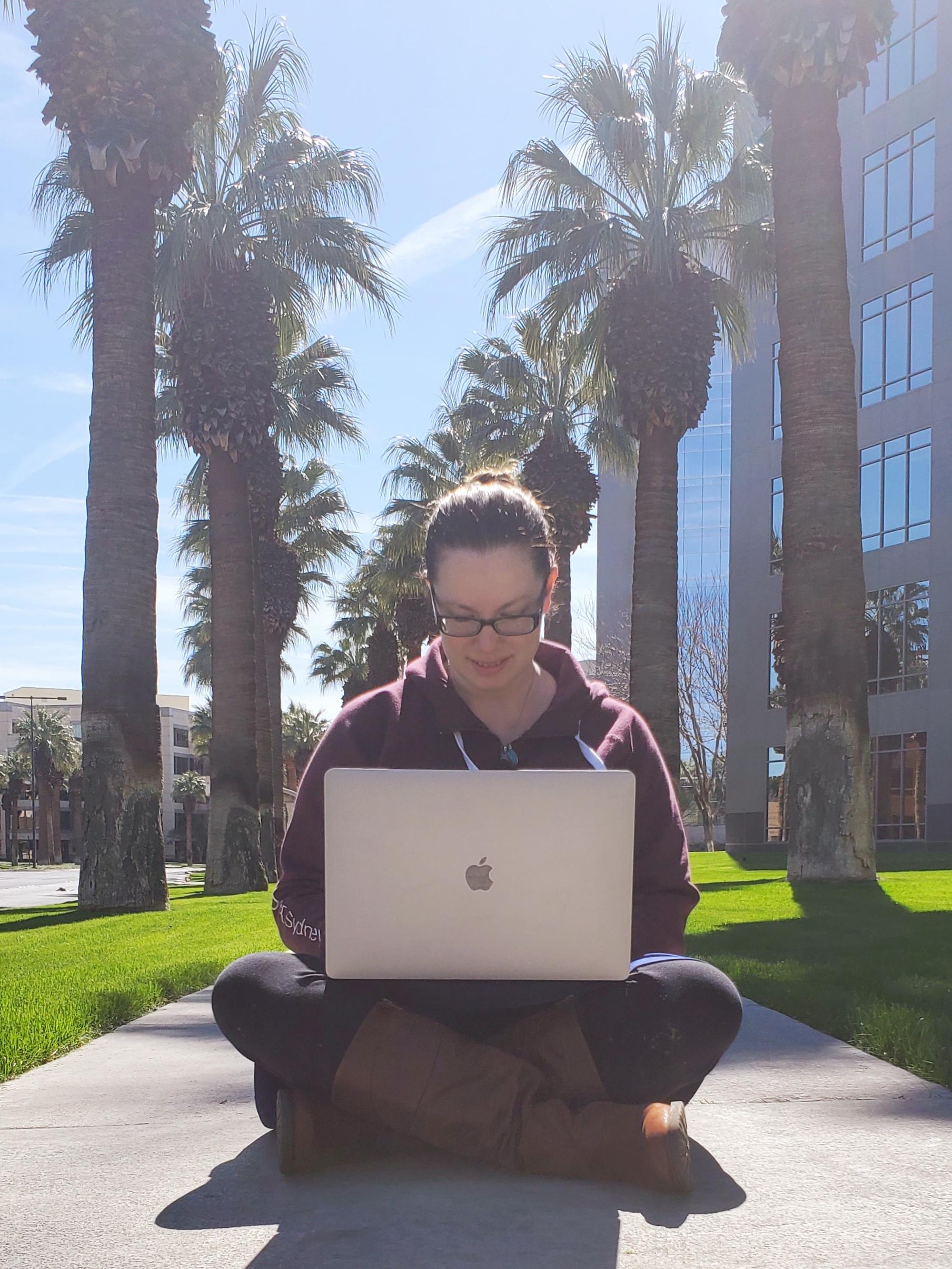 Working remote on the sidewalk