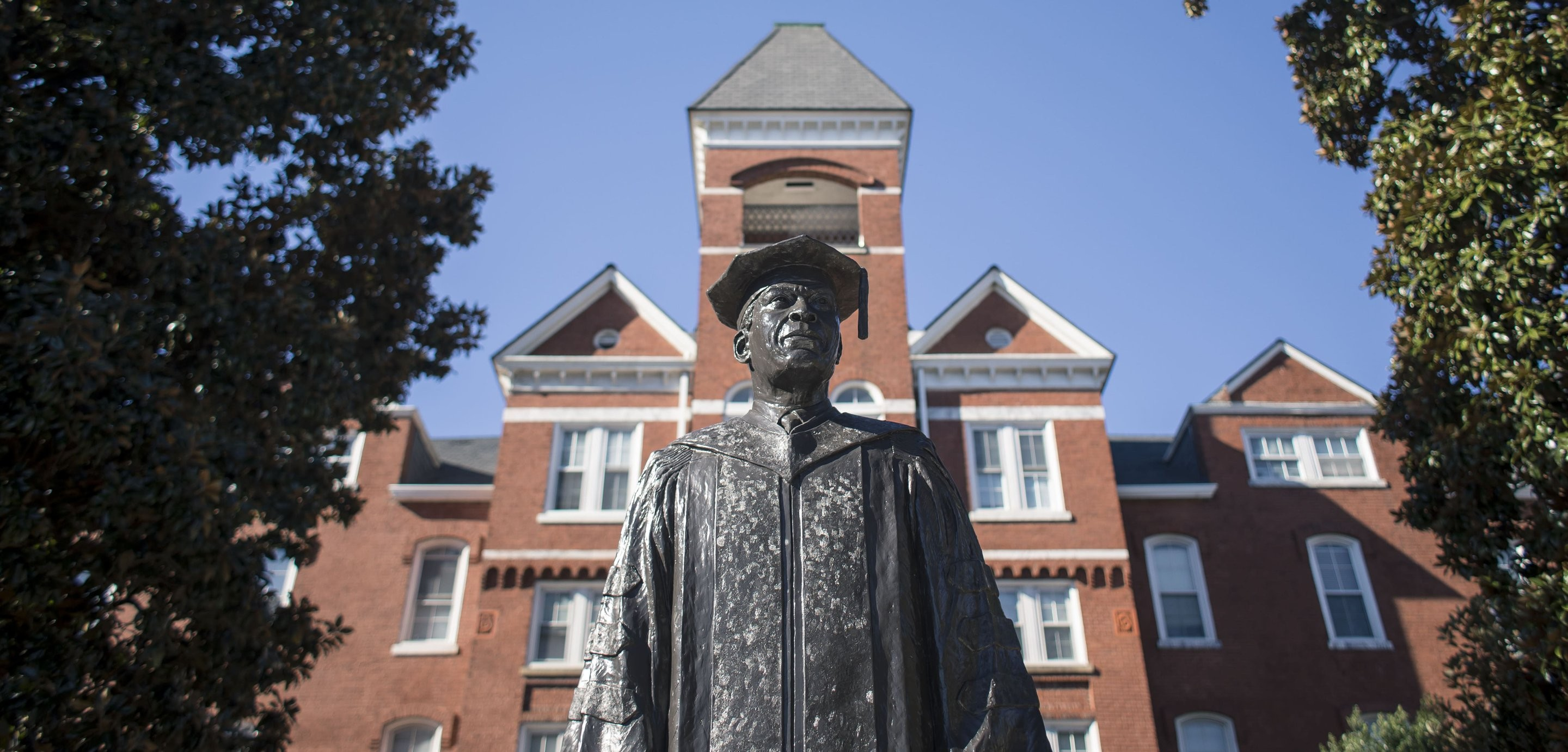 Image of a statue in front of a building at Morehouse College