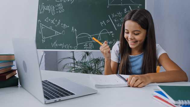 Happy girl studying math