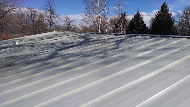A much larger metal roof with overlapping metal strip type sheeting, from Mr Money Mustache.