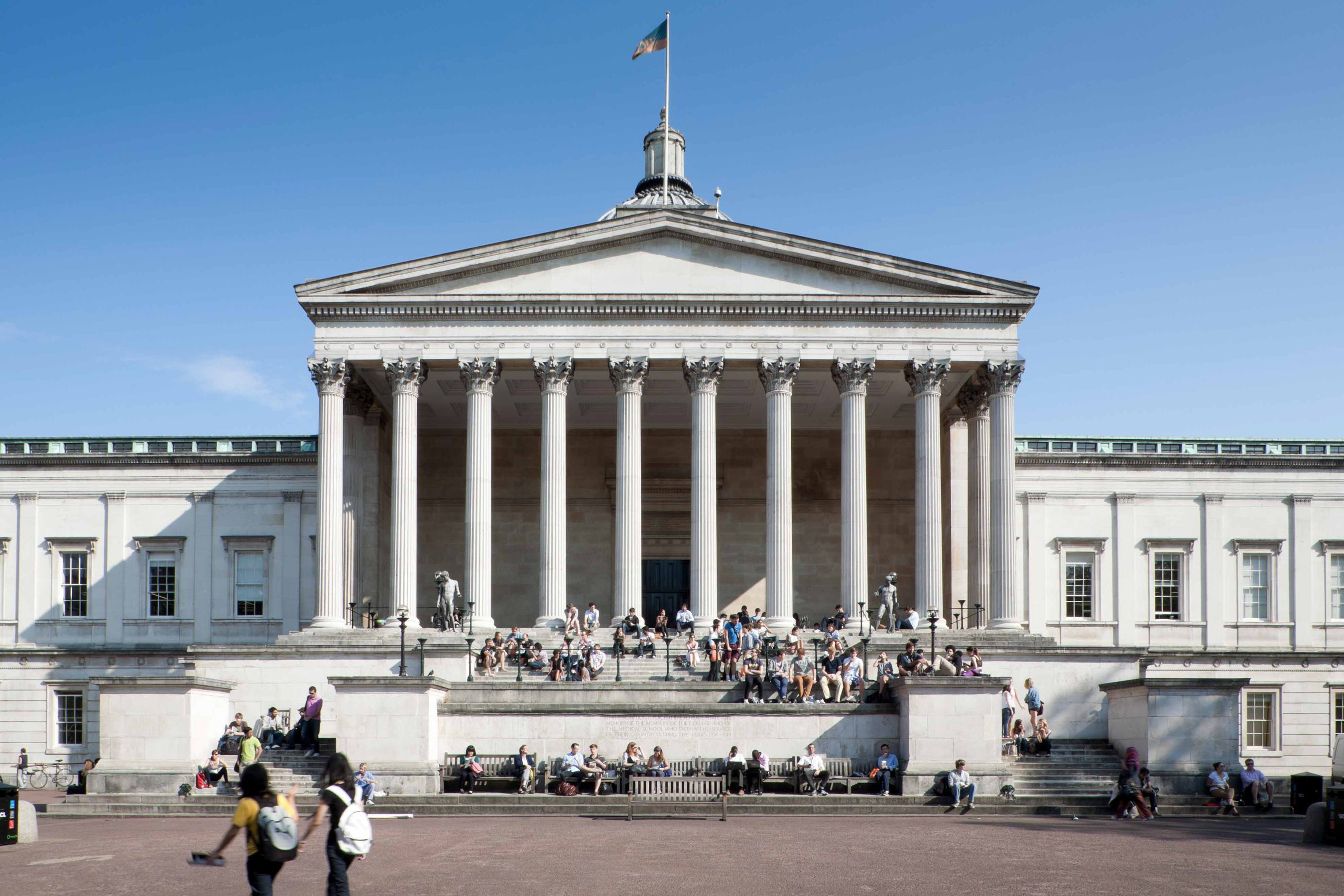 Students socializing and reading on the steps and quad at UCL's Main Building
