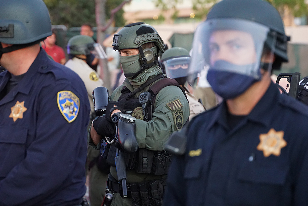 Most officers eschewed masks, but this SWAT team member didn't. Photo by Tom Mann.