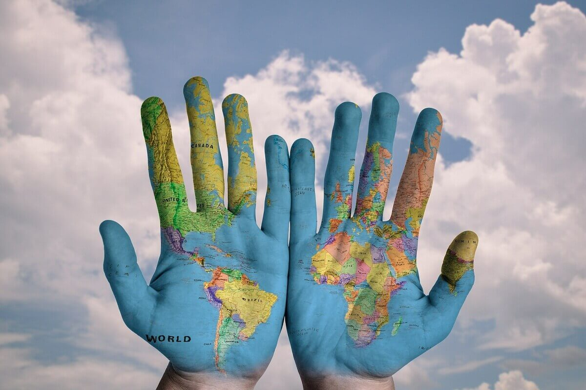 Painting of World Map in Two Hands