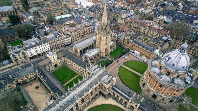 An aerial view of Oxford University's Radcliffe Square showing the dome and steeple structures and other campus buildings