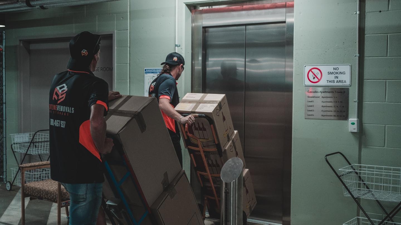 two frontline removalist crew loading stuff