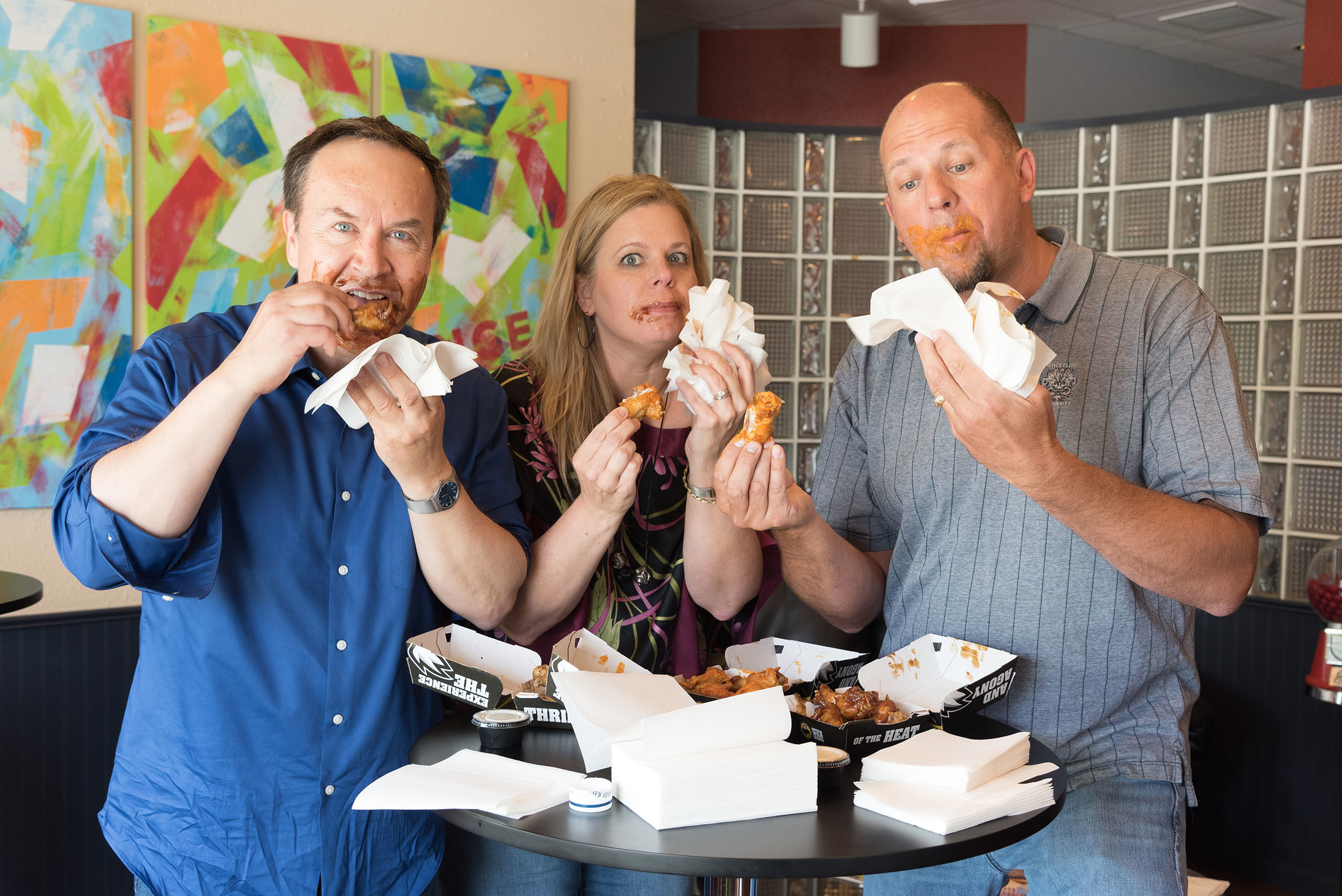 Portrait of group eating wings