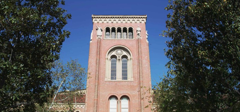 Closeup view of a historic-looking red brick academic building