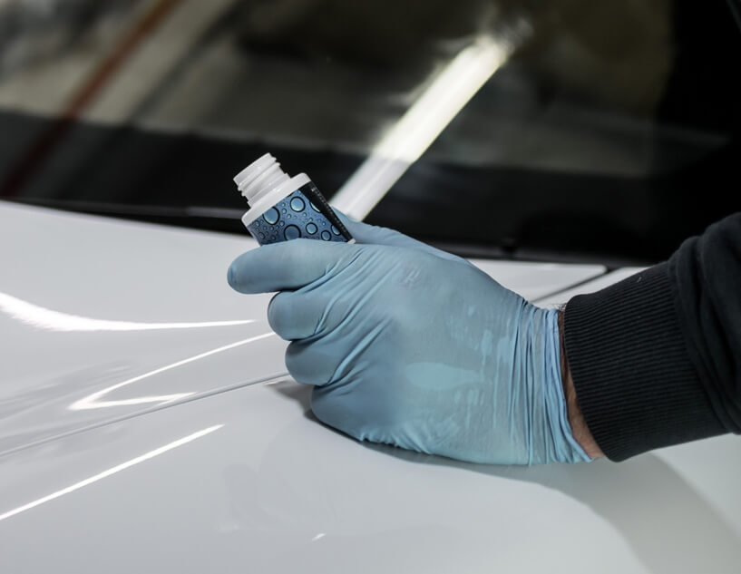 Water repellent being applied to car windowshield
