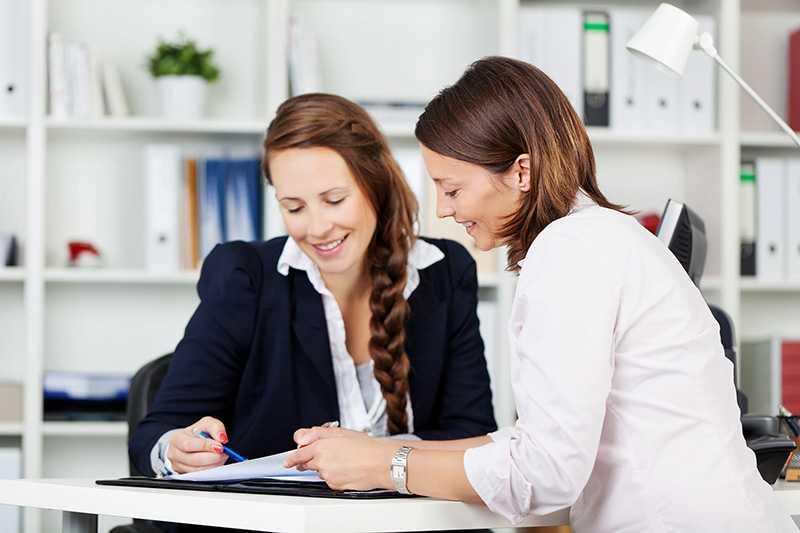 Two women preparing a financial plan