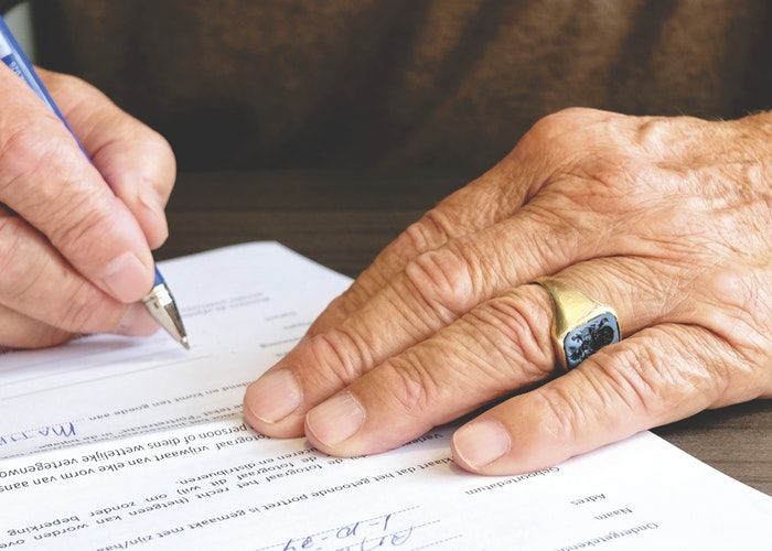 image of person filling out a form