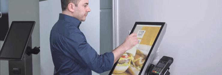 Employee who prepares their order on the self-service ordering kiosk.