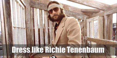 Richie Tenenbaum's outfit is a hybrid of athleticism and looking proper. He wears a beige three-piece suit with a striped sports shirt underneath, a pair of black Oxfords, and sweatbands.