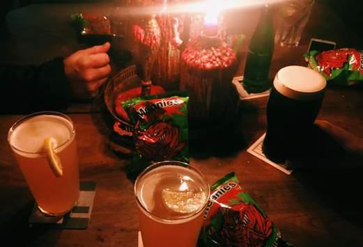candlelit pints and crisps