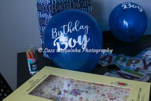 Close up photo of balloon and birthday cake