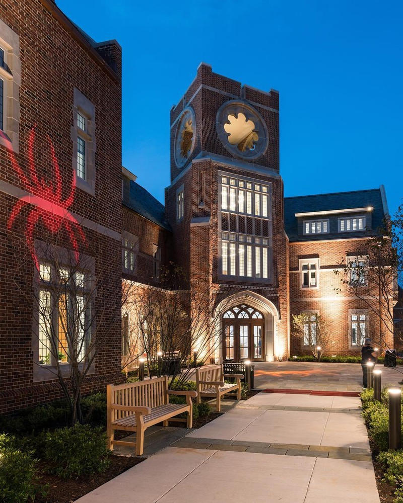 University of Richmond campus building at night with a spider logo