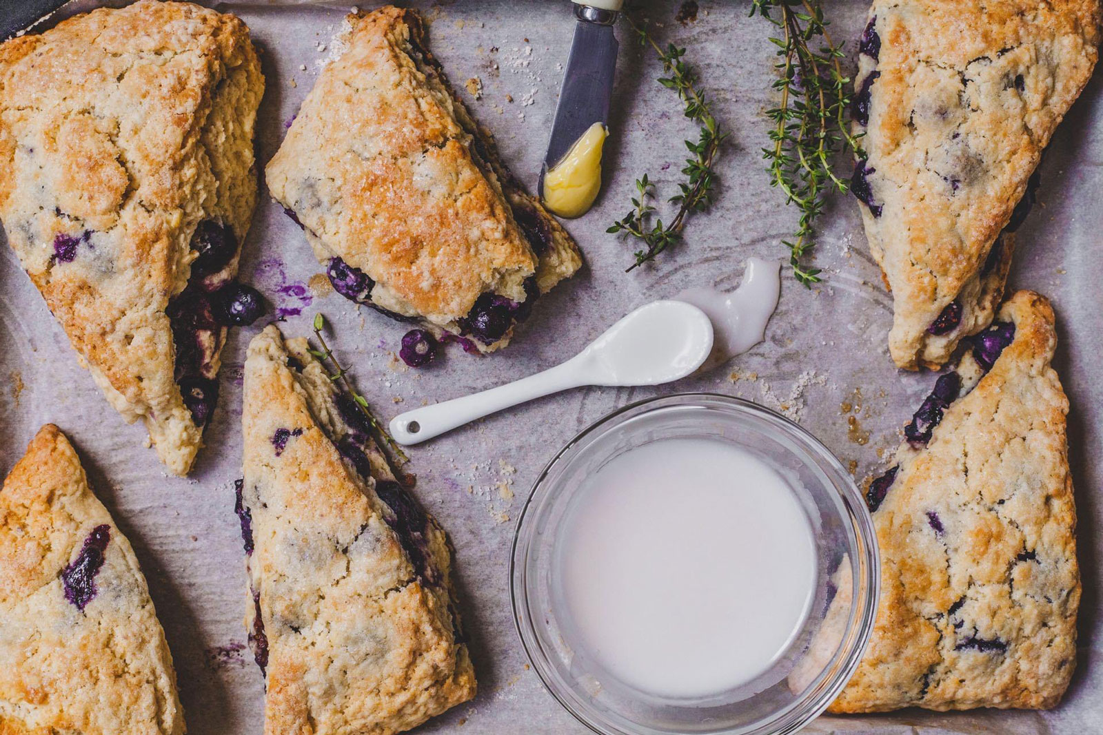 Buttery Blueberry Scones With A Thyme Glaze