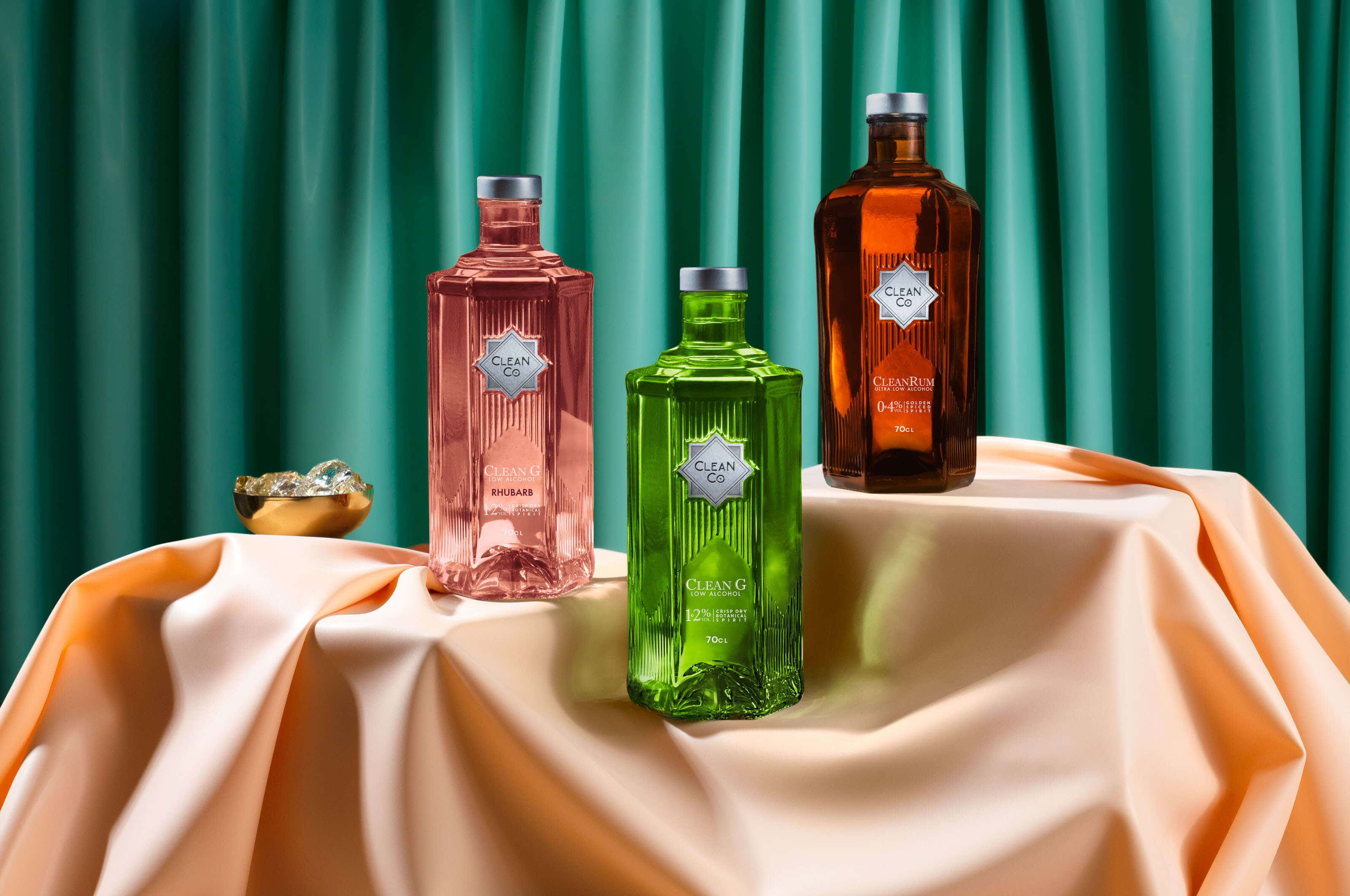 clean co bottles on a pink and green background