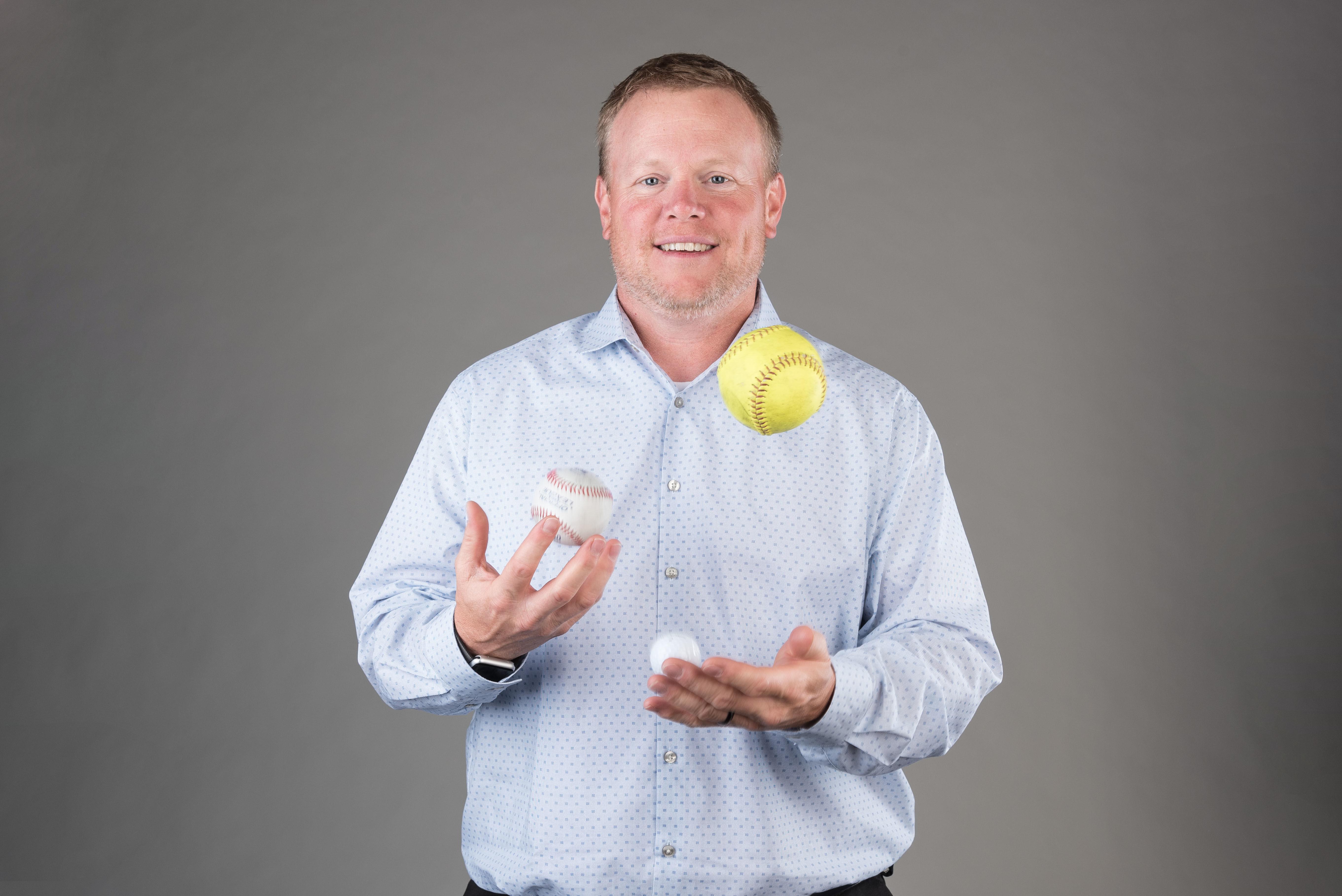 Portrait of man juggling