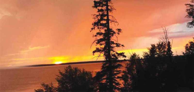 Sunrise over lake in Waskesiu Saskatchewan