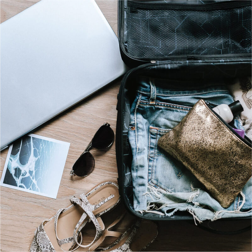 Travel suitcase and accessories laid out open