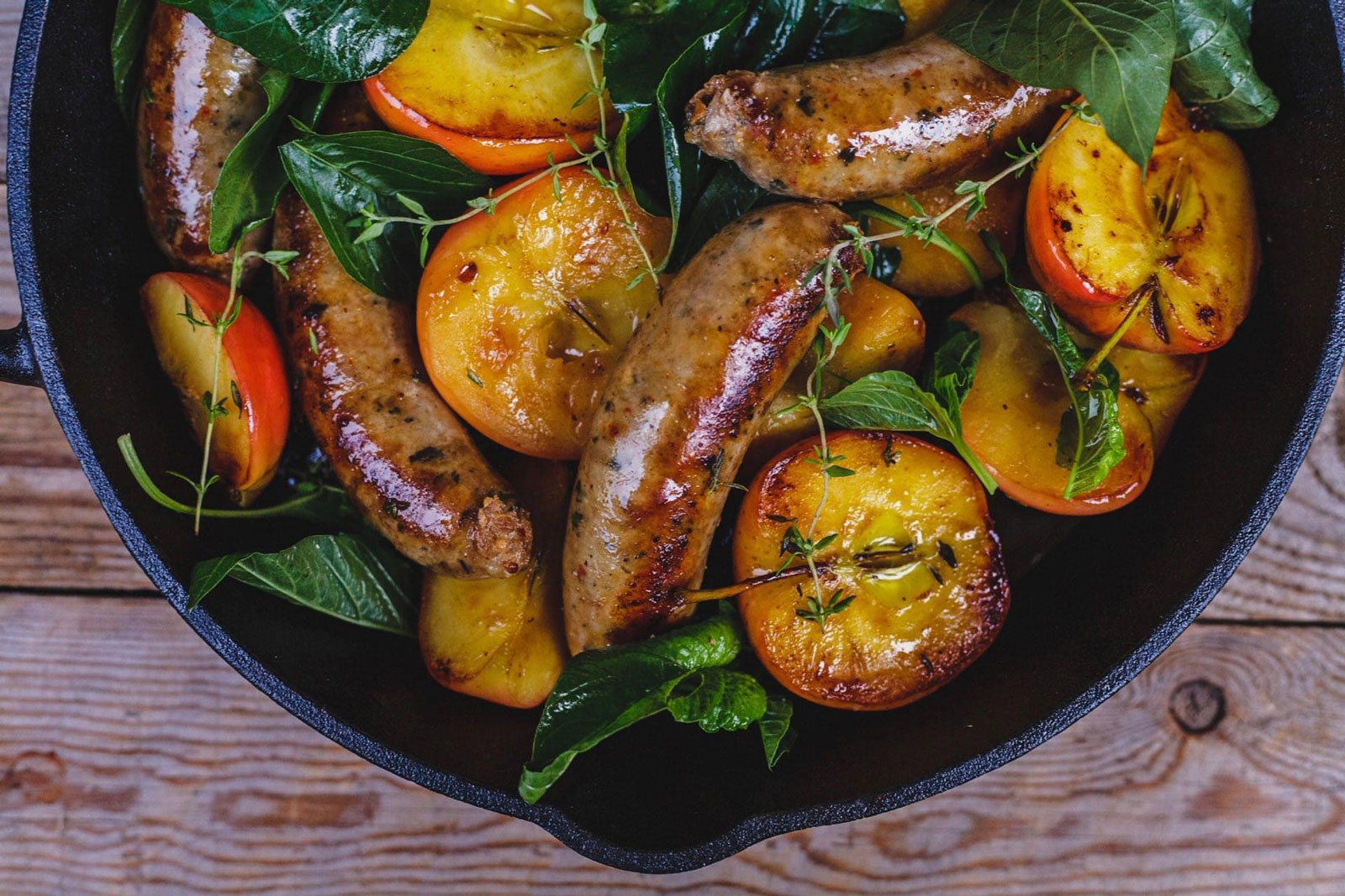Pan Seared Sausages And Apples With Honey, Thyme And Greens