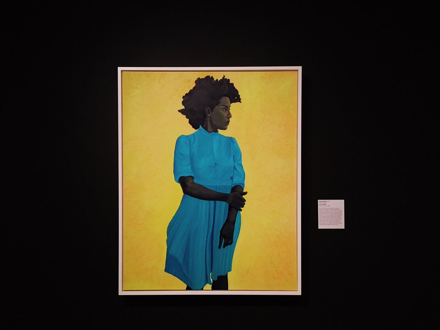 Painting of a black woman in a blue dress
