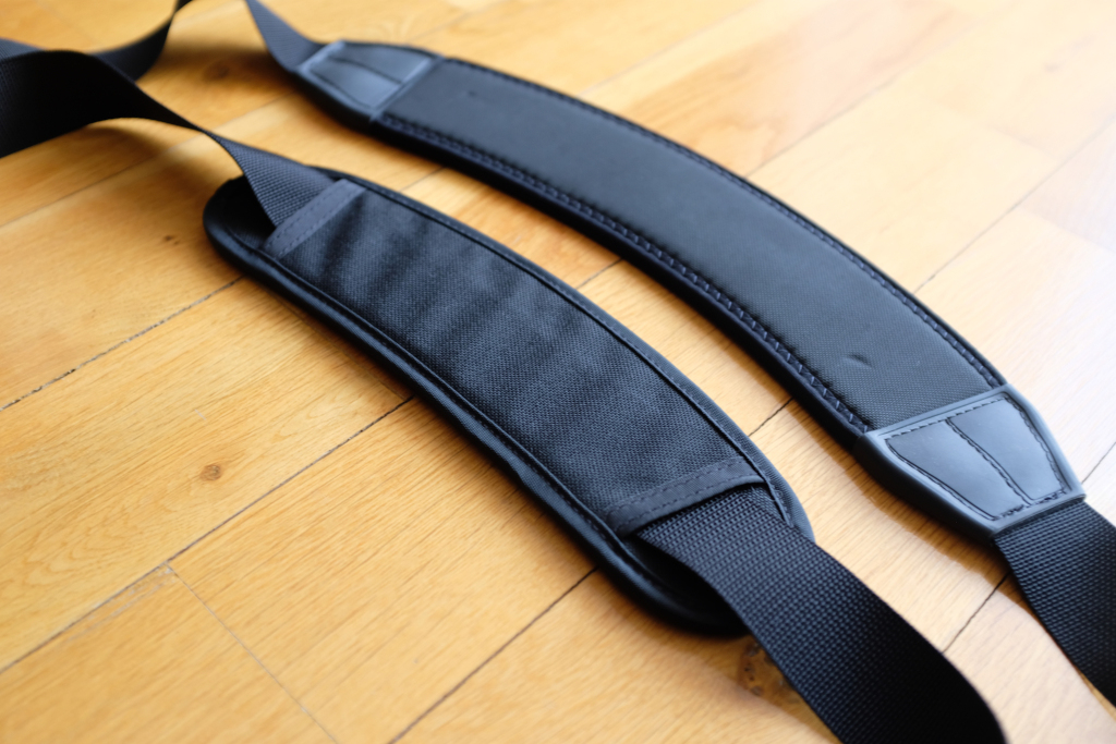 The Absoulute shoulder strap is larger and bigger, which makes it suitable for heavy loads and big bags.