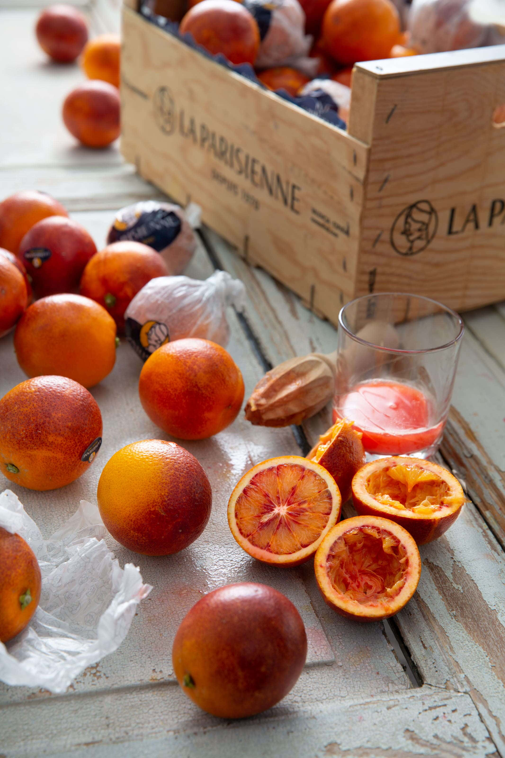 Blood oranges sliced opened and juiced and some in a box.