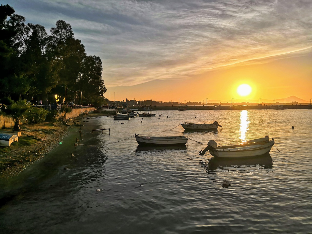 Sunset view with parked fishing boats